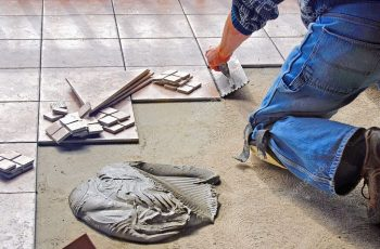 depositphotos_45954025-stock-photo-man-laying-tile-flooring
